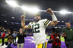 Green Bay Packers quarterback Aaron Rodgers runs off the field after the team's NFL football game against the Minnesota Vikings, Monday, Dec. 23, 2019, in Minneapolis. The Packers won 23-10. (AP Photo/Craig Lassig)