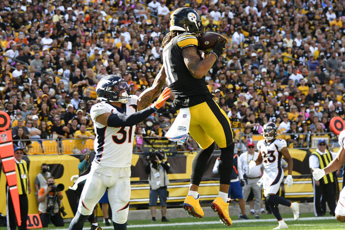 Pittsburgh Steelers wide receiver Chase Claypool (11) catches a pass from quarterback Ben Roethlisberger for a touchdown with Denver Broncos free safety Justin Simmons (31) defending during the second half of an NFL football game in Pittsburgh, Sunday, Oct. 10, 2021. (AP Photo/Don Wright)
