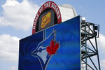 FILE - In this July 24, 2020, file photo, signage at Sahlen Field, home of the Toronto Blue Jays' Triple-A affiliate, in Buffalo, N.Y., is viewed. The Blue Jays will walk onto the field Tuesday, Aug. 11, 2020, as the host team for the first time in 2020. (AP Photo/Jeffrey T. Barnes, File)
