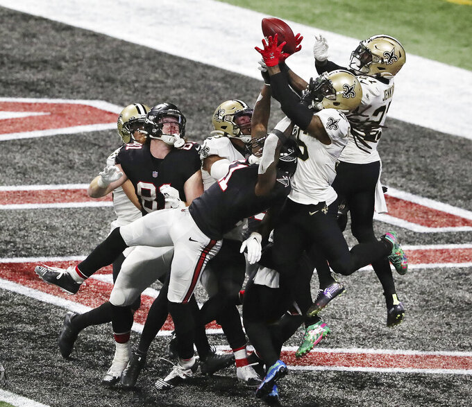 A pass to Atlanta Falcons wide receiver Julio Jones falls incomplete in the end zone as time expires with the New Orleans Saints defending in an NFL football game Sunday, Dec. 6, 2020, in Atlanta. (Curtis Compton/Atlanta Journal-Constitution via AP)