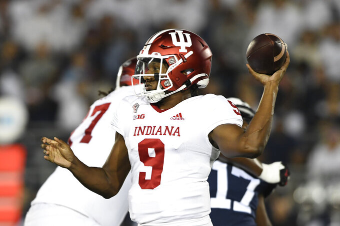Indiana quarterback Michael Penix Jr. (9) passes against Penn State in the first quarter of their NCAA college football game in State College, Pa., on Saturday, Oct. 2, 2021. (AP Photo/Barry Reeger)