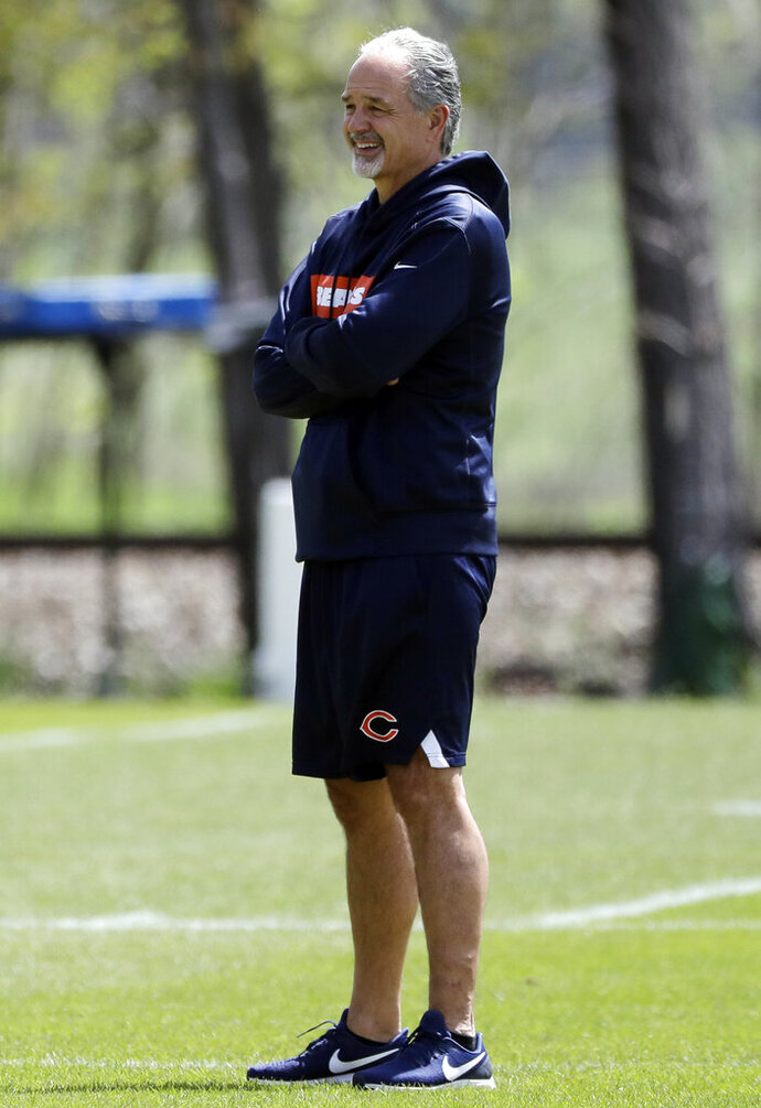 Chicago Bears defensive coordinator Chuck Pagano smiles as he watches his team during NFL football practice in Lake Forest, Ill., Wednesday, May 22, 2019. (AP Photo/Nam Y. Huh)