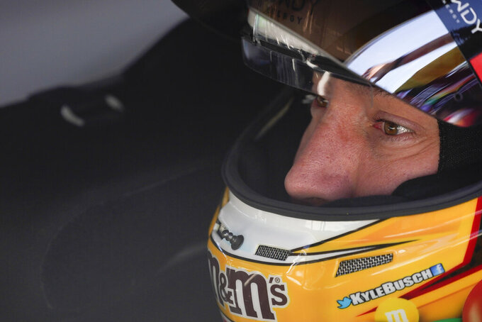 Kyle Busch sits in his car before qualifications for the NASCAR Series auto race at Indianapolis Motor Speedway, Sunday, Aug. 15, 2021, in Indianapolis. (AP Photo/Darron Cummings)