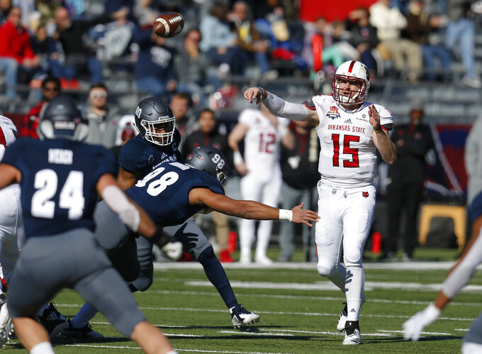 Arkansas State quarterback Justice Hansen (15) throws down field in the first half during an NCAA college football bowl game against Nevada, Saturday, Dec. 29, 2018, in Tucson, Ariz. (AP Photo/Rick Scuteri)