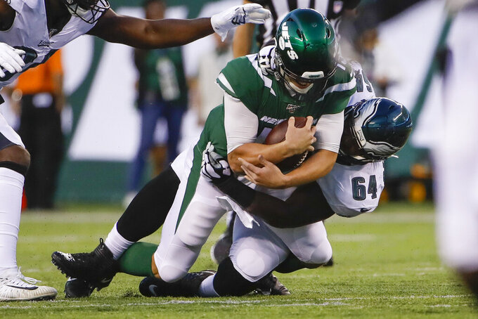 Philadelphia Eagles' Hassan Ridgeway, right, sacks New York Jets quarterback Trevor Siemian during the first half of a preseason NFL football game Thursday, Aug. 29, 2019, in East Rutherford, N.J. (AP Photo/Matt Rourke)