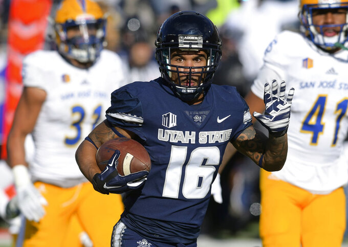 No. 14 Utah State beats SJSU 62-24 for 9th straight win