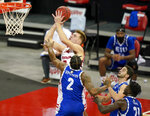 Wisconsin's Tyler Wahl, top, shoots past Eastern Illinois' Jordan Skipper-Brown (2) during the first half of an NCAA college basketball game Wednesday, Nov. 25, 2020, in Madison, Wis. (AP Photo/Andy Manis)