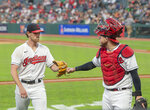 Cleveland Indians starting pitcher Shane Bieber gets a fist bump from Roberto Perez after getting the Chicago White Sox's out during the first inning of a baseball game in Cleveland, Friday, Sept. 24, 2021. Bieber, sidelined with an arm injury is making his first start since June 13. (AP Photo/Phil Long)