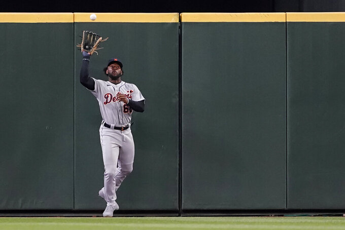 Detroit Tigers center fielder Akil Baddoo catches a deep fly hit by Seattle Mariners' Mitch Haniger during the fourth inning inning of a baseball game Tuesday, May 18, 2021, in Seattle. (AP Photo/Ted S. Warren)