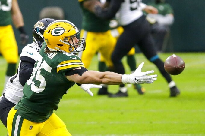 Green Bay Packers' Robert Tonyan can't catch a pass in front of Jacksonville Jaguars' Myles Jack during the first half of an NFL football game Sunday, Nov. 15, 2020, in Green Bay, Wis. (AP Photo/Mike Roemer)