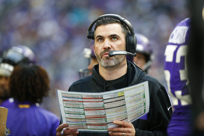 FILE - In this Sunday, Dec. 16, 2018 file photo, Minnesota Vikings interim offensive coordinator Kevin Stefanski watches from the sideline during the first half of an NFL football game against the Miami Dolphins in Minneapolis. The Minnesota Vikings have appointed Kevin Stefanski as offensive coordinator, after his interim stint over the last three games of the season. The 36-year-old Stefanski was promoted on Dec. 11 to replace John DeFilippo, who was fired in his first season on the job amid persistent struggles by the Vikings in moving the ball. Stefanski was a candidate for the head coach vacancy with the Cleveland Browns, who instead picked their own interim offensive coordinator Freddie Kitchens.  (AP Photo/Bruce Kluckhohn, File)