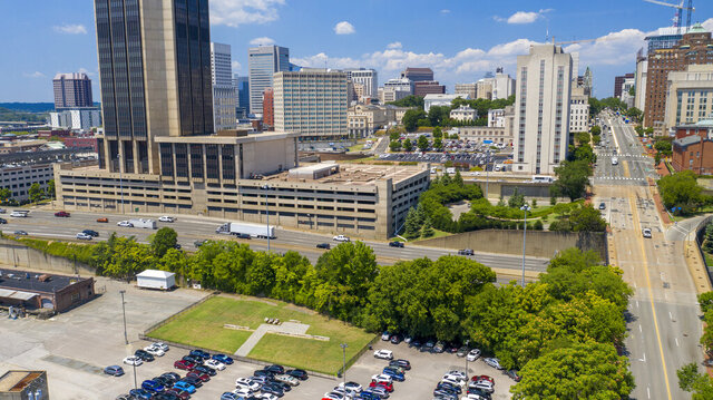 A parking lot and small park mark the location of the Lumpkin's Slave Jail house near downtown Monday, July 27, 2020, in Richmond, Va. It is the site of the Sacred Ground Historical Reclamation Project that was announced by Richmond Mayor Levar Stoney. (AP Photo/Steve Helber)