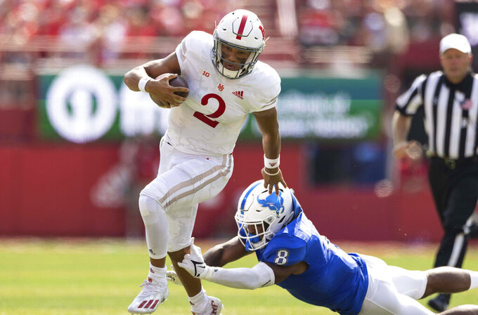 Nebraska quarterback Adrian Martinez (2) carries the ball against Buffalo's James Patterson (8) during the first half of an NCAA college football game, Saturday, Sept. 11, 2021, at Memorial Stadium in Lincoln, Neb. (AP Photo/Rebecca S. Gratz)