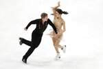 Madison Chock and Evan Bates, of the United States, perform during the ice dance free dance competition at the Four Continents Figure Skating Championships on Sunday, Feb. 10, 2019, in Anaheim, Calif. (AP Photo/Chris Carlson)