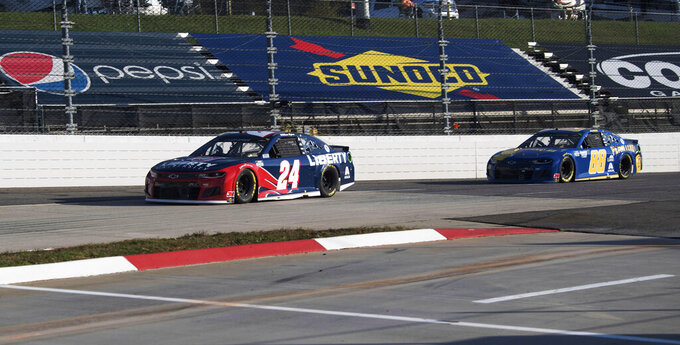 William Byron (24) leads Alex Bowman (88) in turn3 during a NASCAR Cup Series auto race at the Martinsville Speedway in Martinsville, Va., Sunday, Nov. 1, 2020. (AP Photo/Lee Luther Jr.)