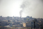 In this photo taken from the Turkish side of the border between Turkey and Syria, in Ceylanpınar, Sanliurfa province, southeastern Turkey, smoke billows from targets inside Syria, in the town of Ra's al-Ayn, during bombardment by Turkish forces Thursday, Oct. 10, 2019. (AP Photo/Lefteris Pitarakis)