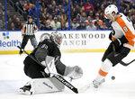 Tampa Bay Lightning goaltender Andrei Vasilevskiy (88) makes a save as Philadelphia Flyers defenseman Robert Hagg (8) looks for a rebound during the third period of an NHL hockey game Saturday, Feb. 15, 2020, in Tampa, Fla. (AP Photo/Jason Behnken)
