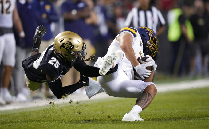 Colorado cornerback Nikko Reed, left, stops Northern Colorado running back Tru Wilson after a reception during the second half of an NCAA college football game Friday, Sept. 3, 2021, in Boulder, Colo. Colorado won 35-7. (AP Photo/David Zalubowski)