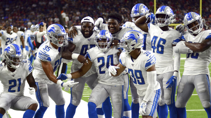 Detroit Lions defensive back Andrew Adams (24) celebrates with teammates after intercepting a pass against the Houston Texans during the first half of an NFL preseason football game Saturday, Aug. 17, 2019, in Houston. (AP Photo/Mike Marshall)