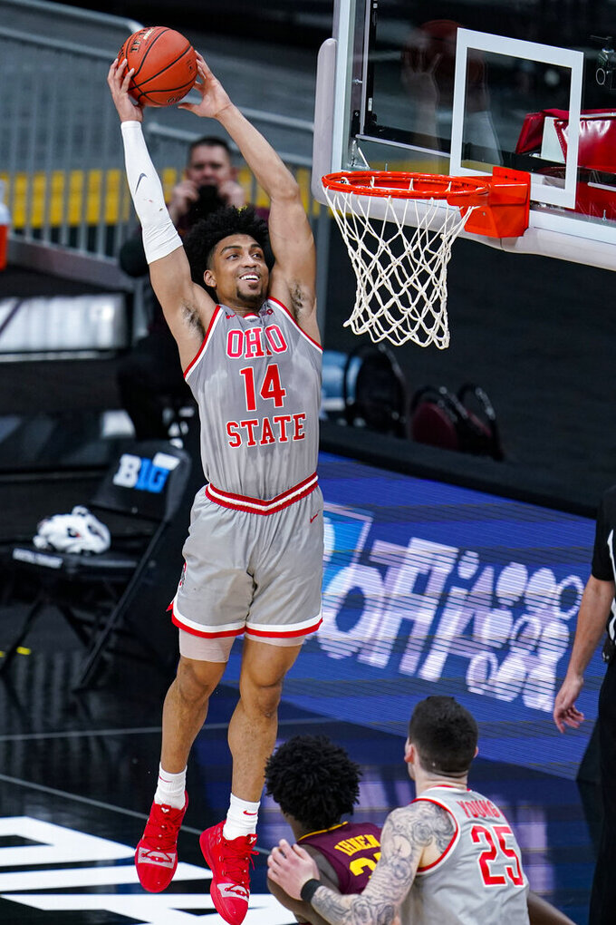 Ohio State center Ibrahima Diallo (15) dunks against Minnesota in the first half of an NCAA college basketball game at the Big Ten Conference tournament in Indianapolis, Thursday, March 11, 2021. (AP Photo/Michael Conroy)
