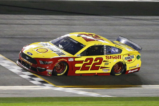 Joey Logano crosses the finish line to win the first of the two NASCAR Daytona 500 qualifying auto races at Daytona International Speedway, Thursday, Feb. 13, 2020, in Daytona Beach, Fla. (AP Photo/Terry Renna)
