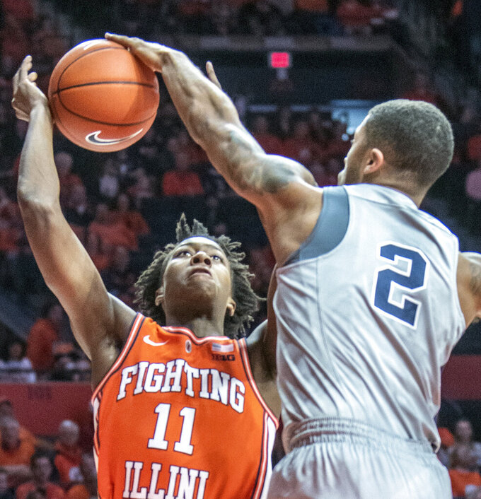Illinois guard Ayo Dosunmu (11) has a shot knocked away by Penn State' guard Myles Dread (2) during the first half of an NCAA college basketball game in Champaign, Ill., Saturday, Feb. 23, 2019.(AP Photo/Robin Scholz)
