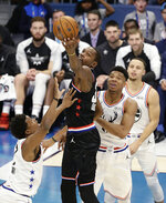 Team LeBron's Kevin Durant, of the Golden State Warriors works against Team Giannis during the second half of an NBA All-Star basketball game, Sunday, Feb. 17, 2019, in Charlotte, N.C. (AP Photo/Gerry Broome)