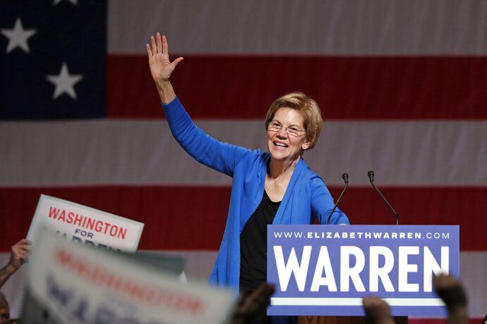 Democratic presidential candidate U.S. Sen. Elizabeth Warren, D-Mass., waves as she finishes speaking during a campaign event Saturday, Feb. 22, 2020, in Seattle. (AP Photo/Elaine Thompson)