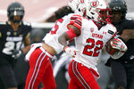 Utah running back Ty Jordan runs for a touchdown against Colorado in the second half of an NCAA college football game Saturday, Dec. 12, 2020, in Boulder, Colo. Utah won 38-21. (AP Photo/David Zalubowski)