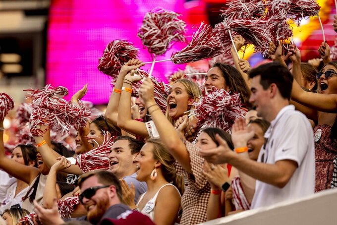 Alabama fans cheer during the second half of an NCAA college football game against Mercer, Saturday, Sept. 11, 2021, in Tuscaloosa, Ala. (AP Photo/Vasha Hunt)