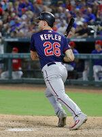 Minnesota Twins' Max Kepler follows through on an RBI single during the fifth inning of the team's baseball game against the Texas Rangers in Arlington, Texas, Saturday, Aug. 17, 2019. (AP Photo/Tony Gutierrez)