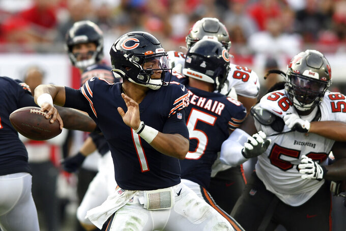 Chicago Bears quarterback Justin Fields (1) throws a pass against the Tampa Bay Buccaneers during the first half of an NFL football game Sunday, Oct. 24, 2021, in Tampa, Fla. (AP Photo/Jason Behnken)