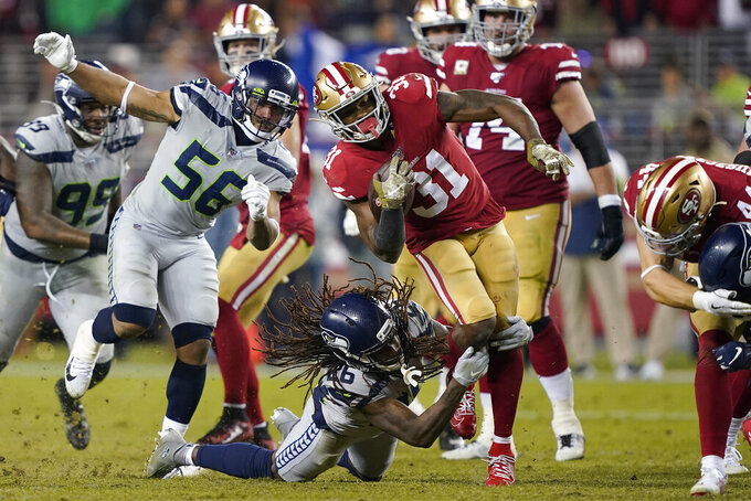 San Francisco 49ers running back Raheem Mostert (31) runs against Seattle Seahawks cornerback Shaquill Griffin (26) during overtime of an NFL football game in Santa Clara, Calif., Monday, Nov. 11, 2019. (AP Photo/Tony Avelar)