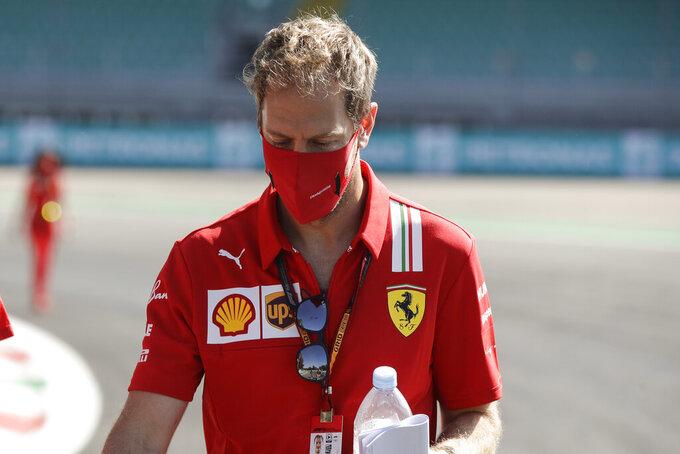 Ferrari driver Sebastian Vettel of Germany walks at the Monza racetrack in Monza, Italy, Thursday, Sept.3 , 2020. The Italian Formula One Grand Prix will be held on Sunday. (AP Photo/Luca Bruno)