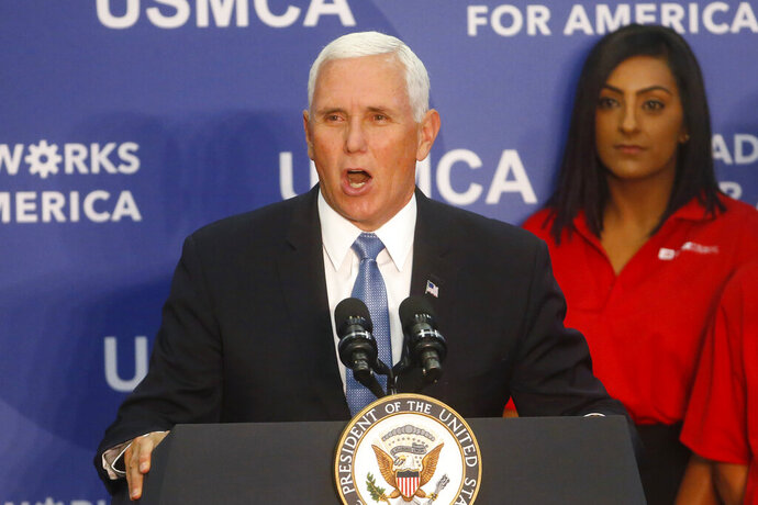 Vice President Mike Pence speaks at medical-device manufacturer Merit Medical Thursday, Aug. 22, 2019, in South Jordan, Utah. Pence is visiting Utah as the next stop on a trip to promote the Trump administration's trade deal with Mexico and Canada. (AP Photo/Rick Bowmer)