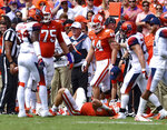 Clemson quarterback Trevor Lawrence lays on the ground after being injured during the first half of an NCAA college football game against Syracuse, Saturday, Sept. 29, 2018, in Clemson, S.C. (AP Photo/Richard Shiro)