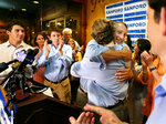 U.S. Rep. Mark Sanford hugged his sons after addressing his supporters at Liberty Tap Room in Mount Pleasant, S.C., Tuesday, June 12, 2018. Sanford lost his first election ever Tuesday, beaten for the Republican nomination for another term in the coastal 1st District around Charleston by state Rep. Katie Arrington.  (Wade Spees/The Post And Courier via AP)
