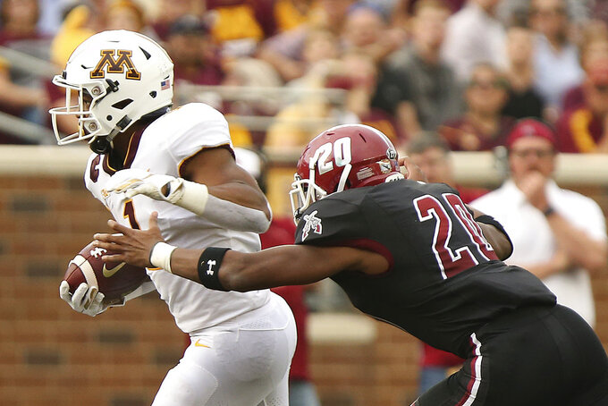 Minnesota running back Rodney Smith (1) controls the ball against New Mexico State linebacker Jonathan Hood (20) during an NCAA college football game Thursday, Aug. 30, 2018, in Minneapolis. (AP Photo/Stacy Bengs)
