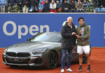Cristian Garin of Chile receives the key for the winner's car at the Munich ATP tennis tournament, after defeating Italy's Matteo Berrettini in the final match, in Munich, Germany, Sunday, May 5, 2019. (AP Photo/Matthias Schrader)