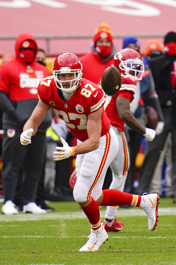 Kansas City Chiefs tight end Travis Kelce catches a pass during the first half of an NFL divisional round football game against the Cleveland Browns, Sunday, Jan. 17, 2021, in Kansas City. (AP Photo/Jeff Roberson)