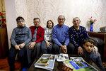 From left: Adil Sharifov's grandson Ramazan Sharifov, uncle Ramiz Humbatov, sister Kamala Sharifova, Adil Sharifov, his mother Adila Ahmadova and grandson Tariyel Sharifov pose for a photo at home in Baku, Azerbaijan, Friday, Nov. 20, 2020. Adil Sharifov, 62, who left his hometown in 1992 during the first war and lives in Azerbaijan's capital, Baku, knows he will find similar devastation if he returns to the city of Jabrayil, which he longs to do. (AP Photo/Aziz Karimov)
