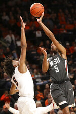 Washington State's Marvin Cannon shoots over Oregon State's Ethan Thompson during the first half of an NCAA college basketball game in Corvallis, Ore., Thursday, Jan. 24, 2019. (AP Photo/Amanda Loman)