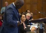 Myanmar's leader Aung San Suu Kyi, seated, watches as Gambia's Justice Minister Aboubacarr Tambadou gets up to address judges in the court room of the International Court of Justice for the first day of three days of hearings in The Hague, Netherlands, Tuesday, Dec. 10, 2019. Aung San Suu Kyi will represent Myanmar in a case filed by Gambia at the ICJ, the United Nations' highest court, accusing Myanmar of genocide in its campaign against the Rohingya Muslim minority. (AP Photo/Peter Dejong)