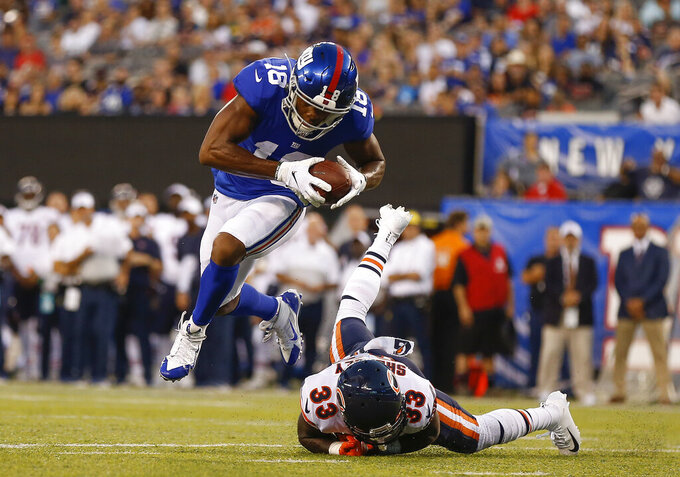 New York Giants wide receiver Bennie Fowler (18) avoids a tackle by Chicago Bears cornerback Duke Shelley (33) on his way to a touchdown against the Chicago Bears during the first quarter of a preseason NFL football game, Friday, Aug. 16, 2019, in East Rutherford, N.J. (AP Photo/Adam Hunger)