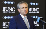 University of North Carolina athletic director Bubba Cunningham makes comments during the NCAA college football team's media day in Chapel Hill, N.C., Monday, Aug. 6, 2018. Following an NCAA violation involving the sale of team-issued shoes, the university announced today that 13 football players will miss games during the 2018 season. (AP Photo/Gerry Broome)