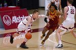 CORRECTS SOUTHERN CALIFORNIA PLAYER TO ISAIAH WHITE (5) INSTEAD OF EVAN MOBLEY (4) - Stanford guard Noah Taitz (20) moves the ball against Southern California guard Isaiah White (5) during the first half of an NCAA college basketball game in Stanford, Calif., Tuesday, Feb. 2, 2021. (AP Photo/Tony Avelar)