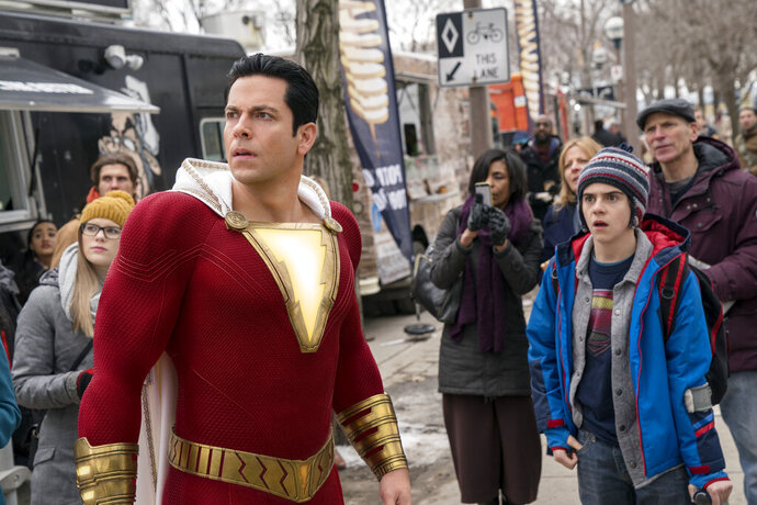 This image released by Warner Bros. shows Zachary Levi, left, and Jack Dylan Grazer in a scene from