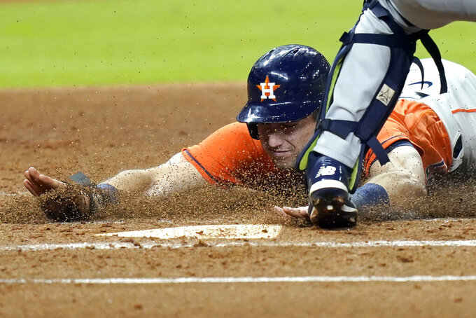 Houston Astros' Kyle Tucker scores during the first inning of a baseball game against the Seattle Mariners Friday, Aug. 14, 2020, in Houston. (AP Photo/David J. Phillip)