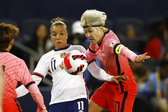 United States forward Mallory Pugh (11) and South Korea midfielder Jl Soyun (10) battle for control of the ball during the second half of an international friendly soccer match in Kansas City, Kan., Thursday, Oct. 21, 2021. (AP Photo/Colin E. Braley)