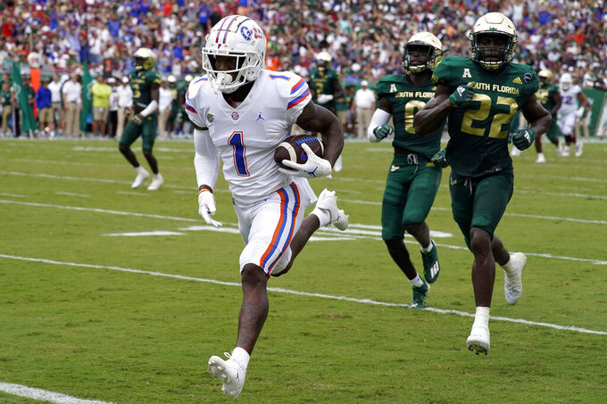 Florida wide receiver Jacob Copeland (1) beats South Florida defensive back Mekhi LaPointe (22) and defensive back Daquan Evans (0) on a 41-yard touchdown reception during the first half of an NCAA college football game Saturday, Sept. 11, 2021, in Tampa, Fla. (AP Photo/Chris O'Meara)